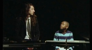 "Kindness teaching a child to play his song ""House"""